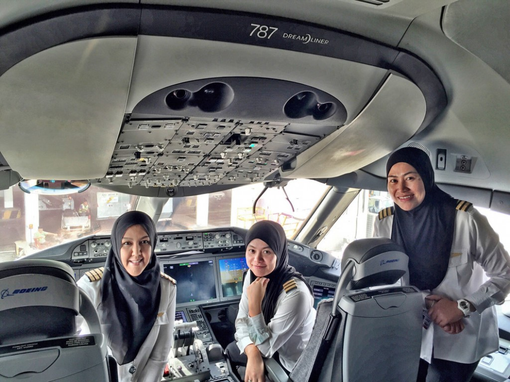 In this Feb. 23, 2016 photo provided by the Royal Brunei Airlines, from left to right, captain Sharifah Czarena, senior flight officer DK Nadiah and senior flight officer Sariana have their picture taken prior to a flight to Jeddah at Brunei International Airport in Bandar Seri Begawan, Brunei. (Royal Brunei Airlines via AP) NO SALES, NO ARCHIVES